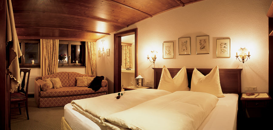 Hotel Haldenhof, Lech, Austria - Bedroom with a sofa.jpg